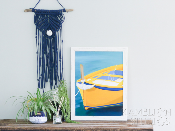Coastal artwork by Kamelion Studios of a wooden fishing boat