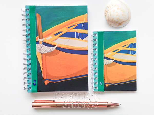 Spiral bound travel diary. Plain page notebook